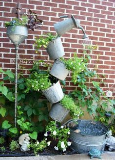 DIY tipsy solar-powered fountain and container garden