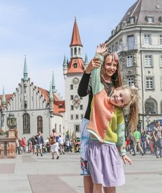 Emily Kornya, who recently moved to this wonderful city, took her friends Sonya and Lina to Marienplatz, the central square in the heart of Munich's Old Town to run around.