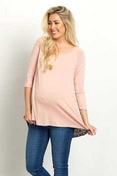 This pretty maternity top is a must-have in our closet this season. A solid front with a floral accent on the back is perfect for a little feminine detail while keeping it simple. Style this top with jeans and boots for a complete look you can wear anywhere.
