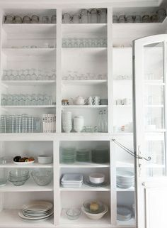 """Ready and Waiting Leach cites the kitchen's open shelving as one of her favorite details. """"There were shelves and shelves of great glassware and china—I loved the way the owners kept them in this perfectly happenstance assortment.""""    Ready and Waiting"""