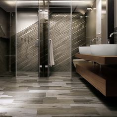 Create a striking focal point in a bath by creating a diagonal pattern with Over Grey porcelain tile that looks like wood by arizonatile.com