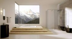 Un'eccellente idea di vasca ad incasso. Gli elementi interni in nero, bianco e legno offrono una splendida vista interna