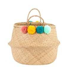 Have a little fun with these Pink Pom Pom Baskets!A large belly basket with a touch of colour, Teal, Pink, Yellow, & Mint pompoms, to create a playful look! Hand-woven, beautiful and functional, the ideal basket to store all those bits and bobs scattered around the house! The perfect basket for storing your books, blankets, laundry and kids toys. Handmade with love by our artisans in Vietnam.Seagrass 42 cm Diameter