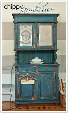 LOVE this chippy farmhouse cabinet with grain sacks behind cabinet doors.