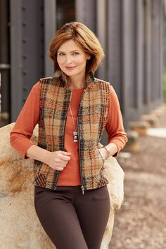 A classic outer layer, this thick vest features a timeless plaid pattern for traditional style that's always on trend.