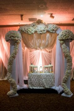 Intricately designed sweet heart table boasting all white flowers
