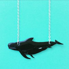 Just listed this new Pilot Whale and calf necklace to my etsy shop! The design for this one originally came from a custom order I did recently.  2 specific whales from the British Columbia pilot whale population, as a gift for a PhD student studying them.  I loved the idea so much though that I thought I'd add a less specific set for you guys to enjoy!   Visit my shop by searching KatieElizabethONeil on etsy or follow the link atop this board.