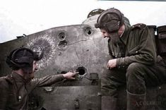 Red Army tank commander, Lt. B.V. Smelov shows the hole in the turret of a destroyed German Tiger I heavy tank (Panzerkampfwagen VI Tiger Ausf. E) to Lt. V.L. Lihnyakevich made with the conventional armour-piercing shell of a 76-mm tank gun fired from a Soviet T-34 medium tank during the Battle of Kursk. Lt. Lihnyakevich was killed in action and buried in Germany in February 1945. Kursk Oblast, Soviet Union. 23 July 1943. This was a well-known photograph that was often used for propaganda…