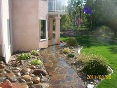 How to build a dry-laid flagstone walkway. An 8 section series with lots of helpful information.