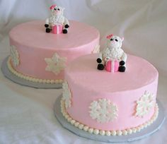 "Winter Lamb - This cake was for a 1st birthday for a little girl who's nick name involves the word Lamb.  Her mom wanted a winter theme but girly :)  They are 8 & 10"" cakes with color flow snowflakes painted in a pearl luster dust.  Iced in butter cream.  Lambs are a fondant/gumpaste blend.  They were SO fun to make and turned out better than I hoped! :)  It was hard to give them up :)"