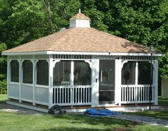 An enormous screened in rectangular gazebo at the end of a gravel and flagstone pathway. Enclosed Gazebo, Screened Gazebo, Hot Tub Gazebo, Backyard Gazebo, Metal Pergola, Backyard Pergola, Modern Gazebo, Flagstone Pathway, Large Gazebo