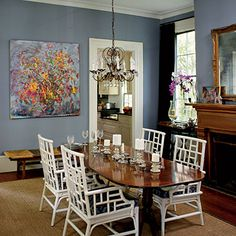 Customize Colors    Tell a cohesive color story in connected spaces. The wall color in this dining room was custom mixed to match the blue undertones of curtains in the adjoining living room.