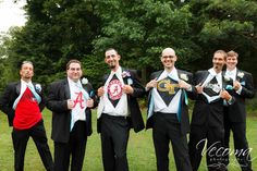 The groom and groomsmen show off their team loyalties in this fun shot!