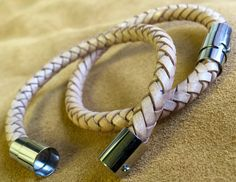 6mm Light Tan, braided leather bracelet with stainless steel clasp.