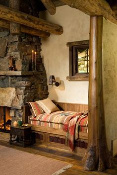 """""""Daybeds on either side of the fireplace are multifunctional,"""" says architectural designer Randy Kaatz. """"They can be used for seating and lounging as well as expanded sleeping space."""" The colors and patterns of the mattresses echo those of Indian rugs."""