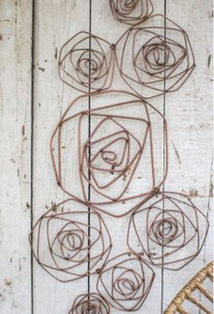 Looking for modern style wall decors? Check of this unique wire wall decor. This is a Wire Roses Wall Sculpture in copper finish. This wall decor can be added to any styled home interior. This copper ~ETS Sculptures Sur Fil, Wall Sculptures, Wire Crafts, Metal Crafts, Wire Hanger Crafts, Metal Tree Wall Art, Metal Art, Wire Wall Art, Wire Flowers
