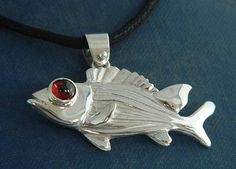 "Squirrel Fish Pendant with Garnet | Sterling Silver pendant with a Garnet eye 1 1/2"" long x 1"" wide $40"
