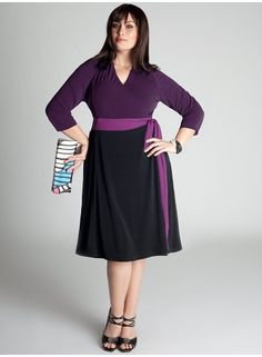 Very on trend, yet timeless - a colorblocked wrap dress version that cinches the waist and skims the curves. Fully lined and side seam pockets for comfort and flattery.