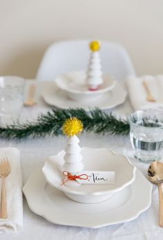 DIY place cards out of cute wooden Christmas trees. Love this for a minimalist holiday table!