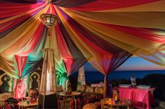 Moroccan/Arabian Nights  theme birthday party. Tent with draping and Moroccan Wall panels. Moroccan lounge area