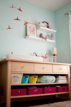 I like that they didn't use a typical changing table in this nursery, something to remember down the road.