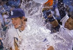 Wil Myers gets drenched by Yunel Escobar after the first walkoff hit of the rookie's career, an RBI single in the 10th. Rays beat Giants  2 - 1. (8-3-13)