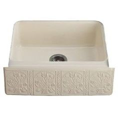 """Undermount kitchen sink with country flowers in a bas-relief.    Product: SinkConstruction Material: MetalColor: BiscuitFeatures:  Five hole faucet drillingIncludes bottom basic rack Dimensions: 8.63"""" H x 25"""" W x 22"""" DNote: Must be installed"""