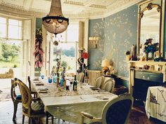 The dining room at Alice Temperley and Lars von Benningsen's country house, Cricket Court, features a mural handpainted by Frederick Wimsett. The vibe is Portobello Market — mixed with bohemian touches.