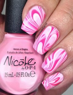 Water Marble Nail Design in Pink and White.