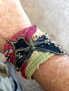 Butterfly cuff, repurposed from old jean & placemat scraps and rescued butterfly appliqué