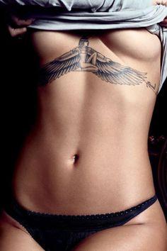 Rihanna's awesome chest tattoo #Nefertiti #PerfectBelly #Tan