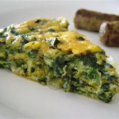 Crustless Spinach Quiche~ This sounds good. I love Muenster cheese. It is suggested you serve this for brunch with a side of sausage links and a fresh fruit bowl!""