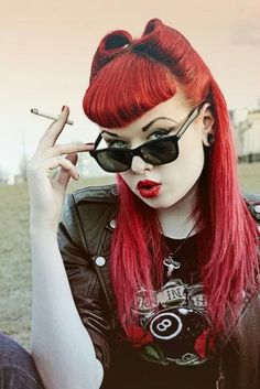 I pinned this because the hairstyle is awesome, she can keep the cigarette