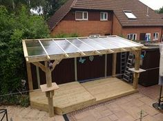 Bespoke Heavy Duty Wooden Pergola with clear roofing panels and stone shelves.