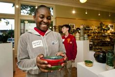 Knox Middle School sixth-grader Fanisha Anderson shows off the pottery she made in the Barnabas Connection after school program