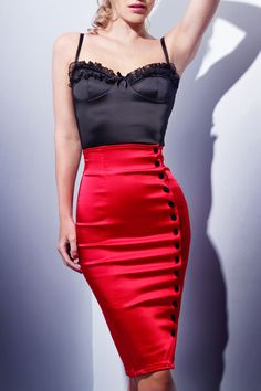 A perenial classic, the Irma La Douce skirt is elegantly cut in double layered stretch matte deluxe satin to create the perfect silhouette. Plush velvet buttons from waist to hip allow garment to be worn sleek and slimline or undone to create a daring cocktail look. High waisted and with zip closure in the centre back for ease of wear. #NicheFashion