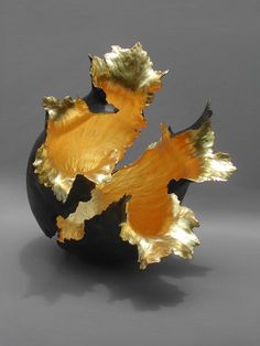 Kay Lynn Sattler makes pit fired coil pots with gold leave inspired by the volcanoes at her home in Hawaii