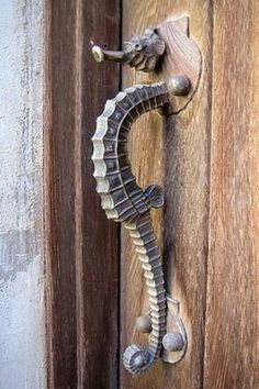 Unique seahorse doorknob and handle, great for beach house.   [original pin: Doorknob]