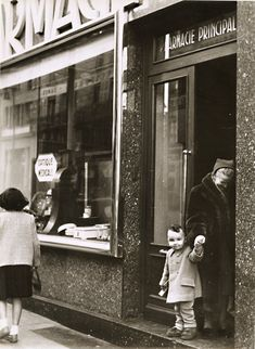 At the Pharmacy by Robert Doisneau-1955