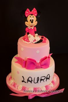 Minnie Mouse cake :) all edible and handmade by me:) - It's pink and ... has a pretty bow!......Polka Dot & Pink Minnie Mouse First Birthday Cake for Laura:)