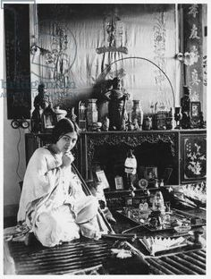 Woman smoking opium, early 20th century (b/w photo)