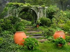 Gardening Gone Wild: at Wesley Rouse's Southbury, CT garden in pergola planning, bigger is better.  Bigger space, bigger timbers, and more mass make pergolas even more dramatic garden features.