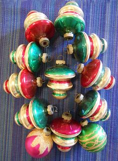1940s Shiny Brite Original Boxed Set of Atomic UFO or Tornado Christmas Ornaments . . . With three tiers and a lobed bottom. In the shape of a UFO, or often described as a tornado or spinning top shape. These are fantastic vintage Shiny Brites! . $95