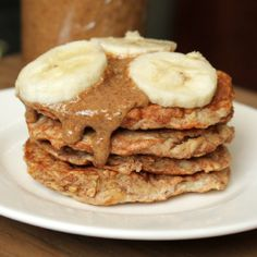 Fluffy, light pancakes w/ hearty oats& sweet banana, topped w/ homemade pecan butter. Gluten-free.
