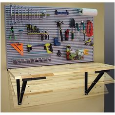 The Fold Away Work Bench with Ideal Wall Storage Solution. Perfect for saving space in the garage! Garage Workbench Plans, Folding Workbench, Diy Workbench, Garage Bench, Steel Workbench, Shed Storage, Wall Storage, Garage Storage, Storage Ideas
