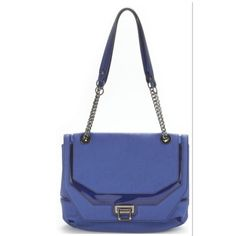 RACHEL ROY COBALT BLUE SHOULDER BAG Super cute for spring and summer with a flip lock closure and silver hardware.. Made of quality man made materials Gently used   A few light scratches on latch from use but doesn't affect the beauty of the bag. Super clean and roomy. RACHEL Rachel Roy Bags Shoulder Bags