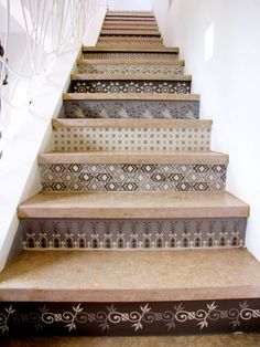 This would actually be great with home made concrete slabs and tiles for the back yard easement Spanish Style Tiled Stair Risers, Remodelista Wallpaper Staircase, Tile Stairs, Basement Staircase, Basement Steps, Staircase Design, Stair Risers, Painted Stairs, Stenciled Stairs, Style Tile