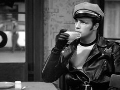 """Marlon Brando has a cup of coffee during a scene from his classic film, """"The Wild One. Marlon Brando, I Love Coffee, Black Coffee, Coffee Break, Happy Coffee, People Drinking Coffee, Coffee Cafe, Drink Coffee, Cool Cafe"""