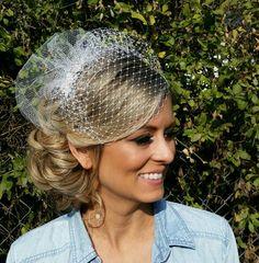Sideswept bride updo, birdcage veil