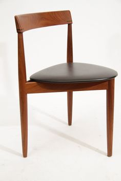 Hans Olsen Teak Dining Table with Extension and Six Chairs | From a unique collection of antique and modern dining room tables at http://www.1stdibs.com/furniture/tables/dining-room-tables/